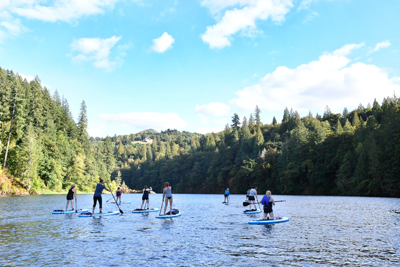 Women Stand Up Paddle Boarding at Lake Merwin on Red Paddle inflatable SUP Boards