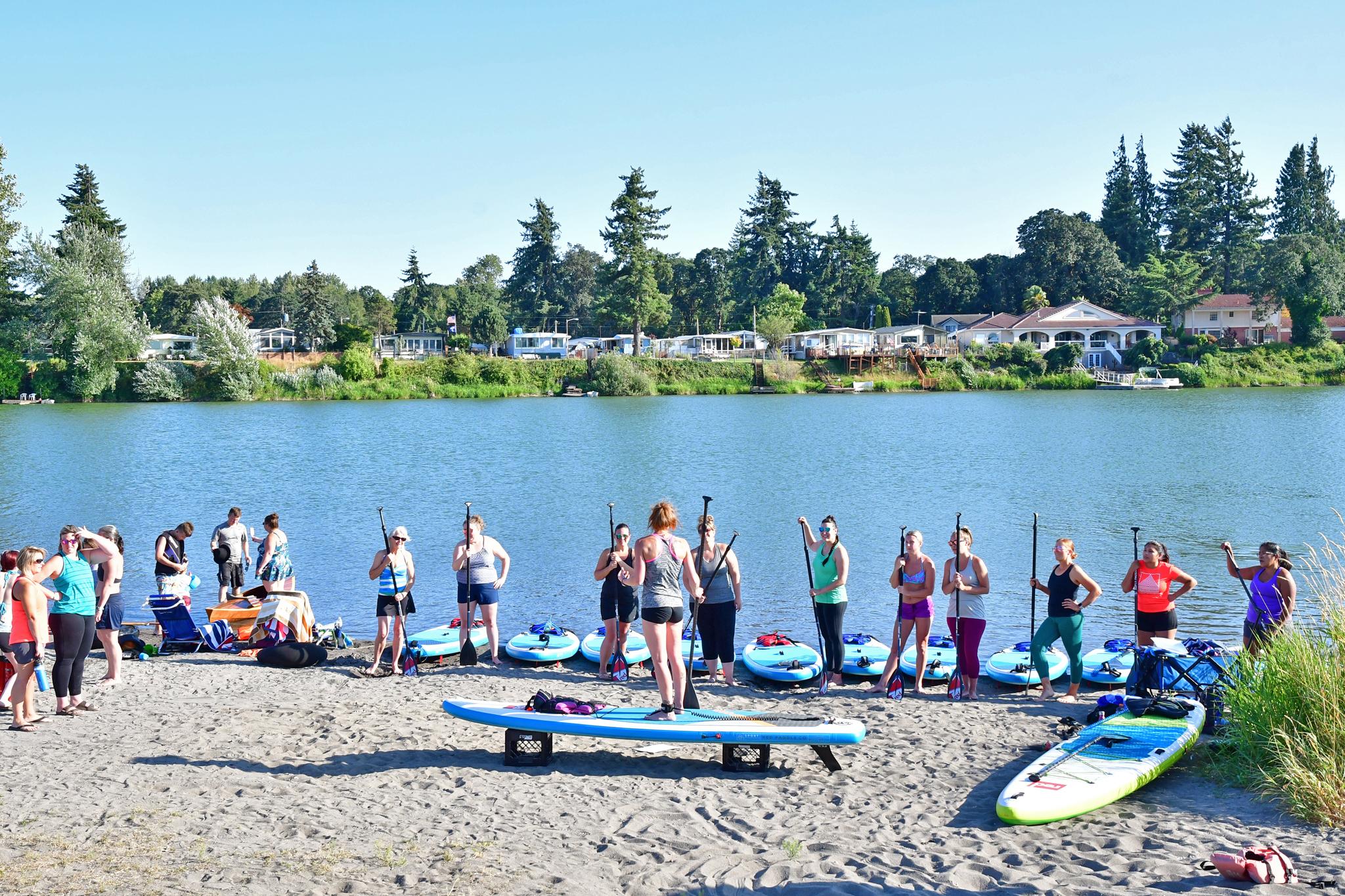 Large Group Womens Fitness paddleboarding at Horseshoe Lake Woodland Washington